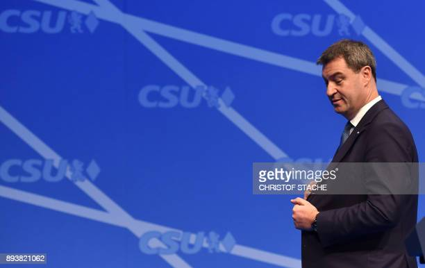 Bavarian Finance Minister Markus Soeder stands at the stage after his speech on December 16 2017 in Nuremberg southern Germany during the congress of...