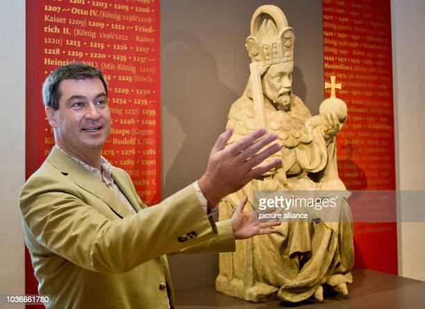 Bavarian finance minister Markus Soeder stands on front of a statue of Kaiser Karl IV in the Kaisersaal in Kaiserburg castle in Nuremberg Germany 11...
