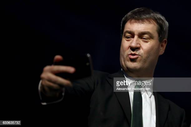 Bavarian Finance Minister Markus Soeder takes a selfie during a rollout event at Munich Airport on February 2 2017 in Munich Germany The Airbus A350...