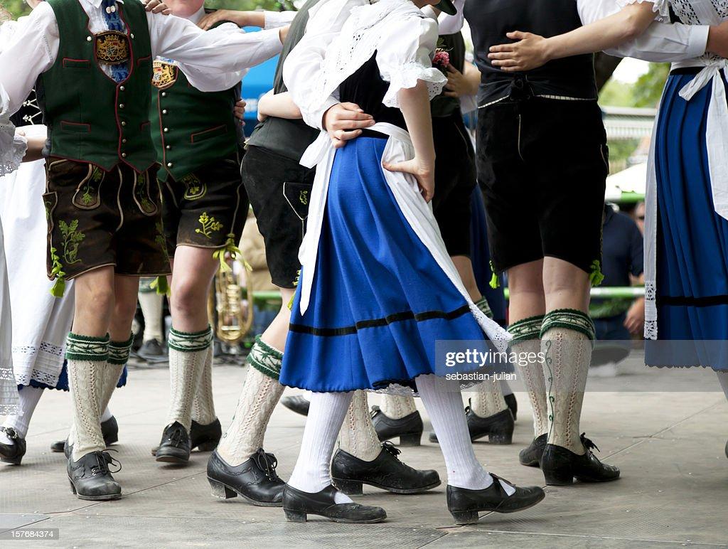 bavarian folk dance at oktoberfest : Stock Photo