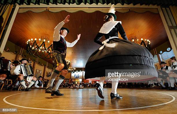 Bavarian folk dancer Hans Huber of the AltMiesbach traditional dance association is accompanied by a socalled Dreherin as he performs a socalled...