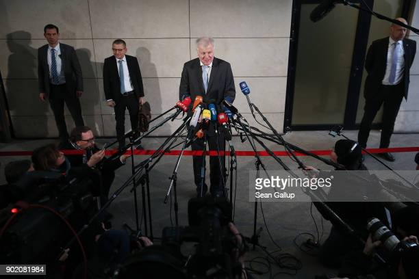 Bavarian Governor and head of the Bavarian Christian Social Union Horst Seehofer speaks to the media as he arrives at the headquarters of the German...