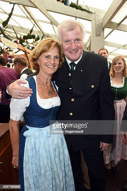 Bavarian Governor Horst Seehofer and his wife Karin attend the Schottenhamel beer tent on the opening day of the 2014 Oktoberfest at Theresienwiese...