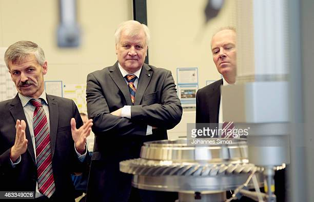 Bavarian Governor Horst Seehofer is guided through a production hall bei Ulrich Peters head of production during a visit at the MTU Aero Engines AG...