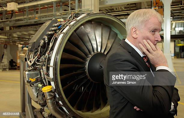 Bavarian Governor Horst Seehofer looks on in front of a jet engine during a visit to the MTU Aero Engines AG production and maintenance facility on...