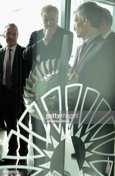 Bavarian Governor Horst Seehofer looks on in front of a turbine during a visit at the MTU Aero Engines AG production and maintenance facility on...