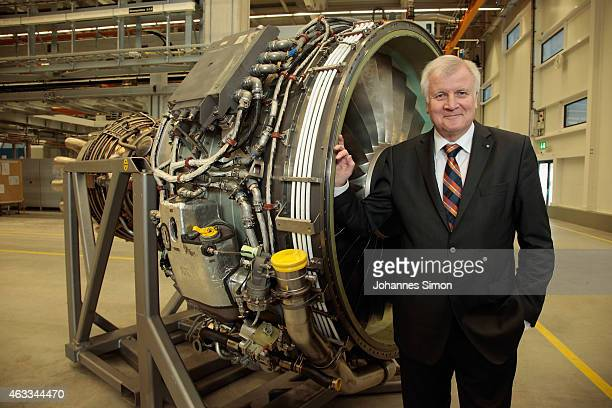 Bavarian Governor Horst Seehofer poses in front of a jet engine during a visit to the MTU Aero Engines AG production and maintenance facility on...