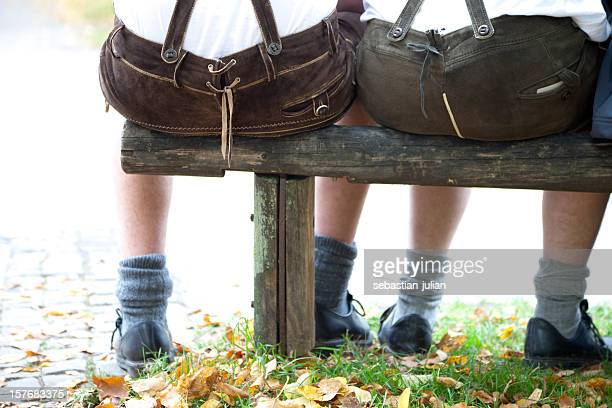 bavarian lederhosen butts at the oktoberfest in munich - bavaria stock photos and pictures
