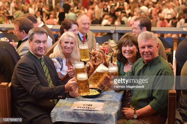 Bavarian MinisterPresident Markus Soeder and his wife Karin Soeder and Munich Mayor Dieter Reiter with his wife Petra Reiter during the opening of...