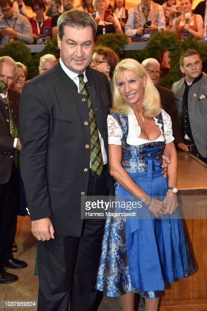 Bavarian MinisterPresident Markus Soeder and his wife Karin Soeder during the opening of the 2018 Oktoberfest beer festival at Theresienwiese on...