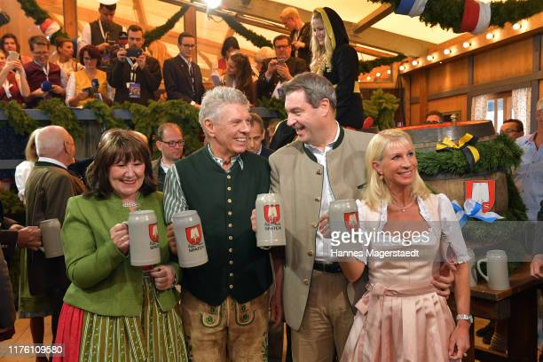 Bavarian Minister-President Markus Soeder and his wife Karin Soeder and Munich Mayor Dieter Reiter with his wife Petra Reiter during the opening of...