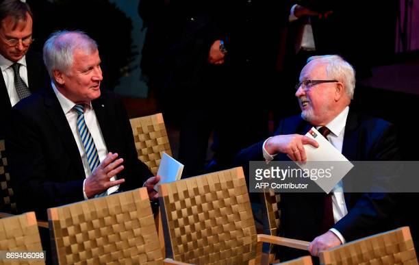 Bavarian premier Horst Seehofer chats with Christian Democratic politician Lothar de Maiziere before an official ceremony on the occasion of the...