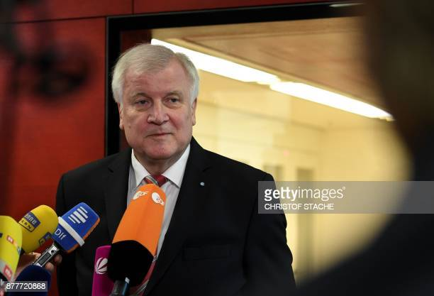 Bavarian Prime Minister and Chairman of the Bavarian Christian Social Union party Horst Seehofer talks to journalists on November 23 2017 at the...