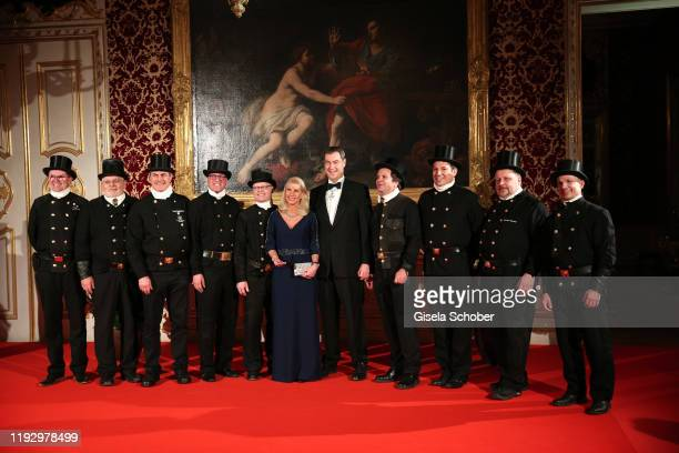 Bavarian Prime Minister Dr. Markus Soeder and his wife Karin Soeder with chimney sweepers during the new year reception of the Bavarian state...