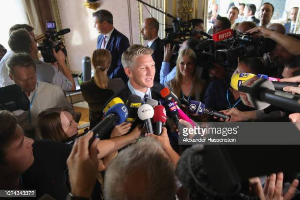 Bavarian Prime Minister Dr. Markus Soeder honors Bastian Schweinsteiger with the Bavarian Order of Merit at Prinz-Carl-Palais on August 27, 2018 in...