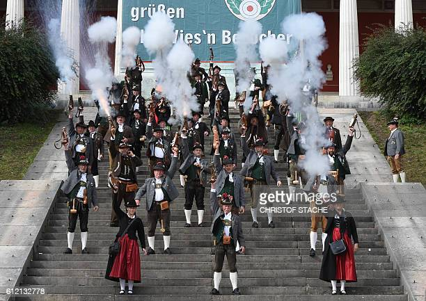 Bavarian riflemen fire gun salutes on the steps of the Bavaria statue at the Theresienwiese fair grounds of the Oktoberfest beer festival in Munich,...