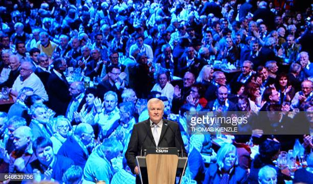 Bavarian State Governor and head of German Christian Social Union Horst Seehofer speaks in front of a screen displaying the spectators during the...