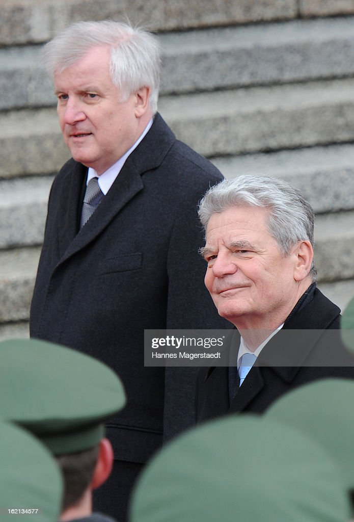 Bavarian state governor Horst Seehofer (L) and German President Joachim Gauck walk past a guard of honour during his inaugural official visit to Bavaria on February 19, 2013 in Munich, Germany. Following his visit to the Bavarian State Chancellery President Gauck's schedule includes visits to the German Aerospace Center in Oberpfaffenhofen and a panel discussion with students at the university of Regensburg.