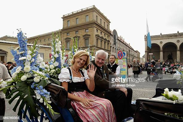 Bavarian state governor Horst Seehofer and his wife Karin Seehofer participate in the Parade of Costumes and Riflemen on the second day of the 2015...
