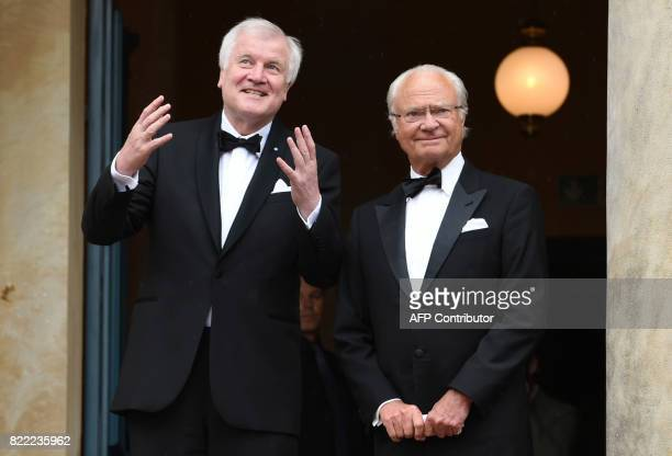 Bavarian State Governor Horst Seehofer and King of Sweden Carl XVI Gustaf arrive at the Festival Theatre on July 25 in Bayreuth southern Germany...