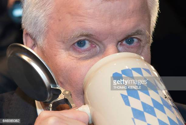 Bavarian State Premier and head of German Christian Social Union party Horst Seehofer drinks out of his his beer mug at the party's traditional Ash...