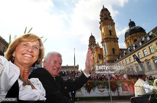 Bavarian state premier Horst Seehofer and his wife Karin smile as they participate in the traditional riflemen's parade of the Oktoberfest on...