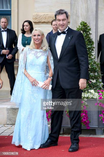 Bavarian state Premier Markus Soeder and his wife Karin Baumueller during the opening ceremony of the Bayreuth Festival at Bayreuth Festspielhaus on...