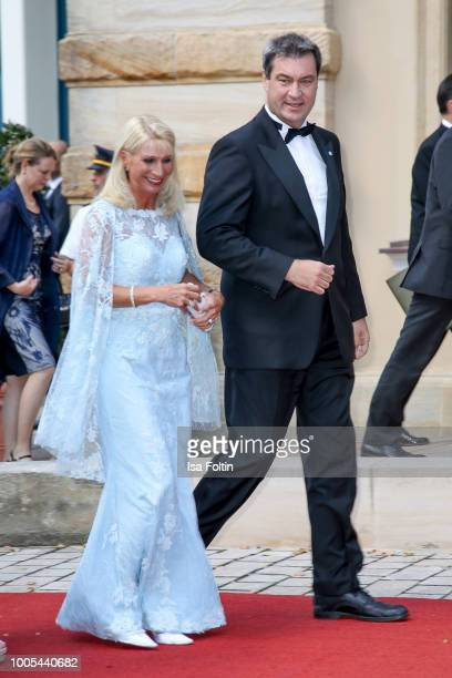 Bavarian State Premier Markus Soeder with his wife Karin Baumueller during the opening ceremony of the Bayreuth Festival at Bayreuth Festspielhaus on...