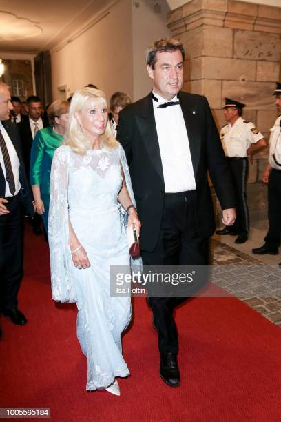 Bavarian State Prime Minister Markus Soeder and his wife Karin Baumueller attend the Bayreuth Festival 2018 state reception at Neues Schloss on July...