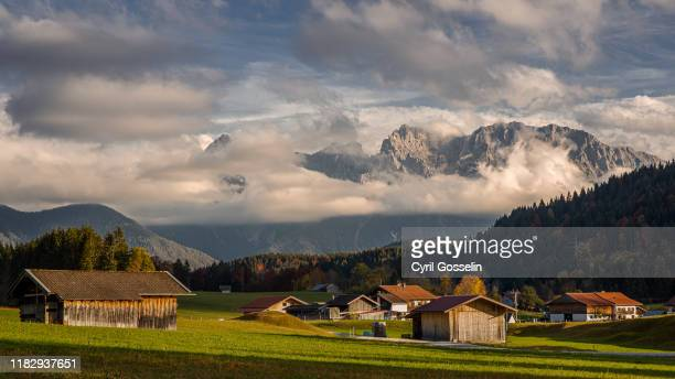 bavarian village of gerold and karwendel mountain range - krün ストックフォトと画像