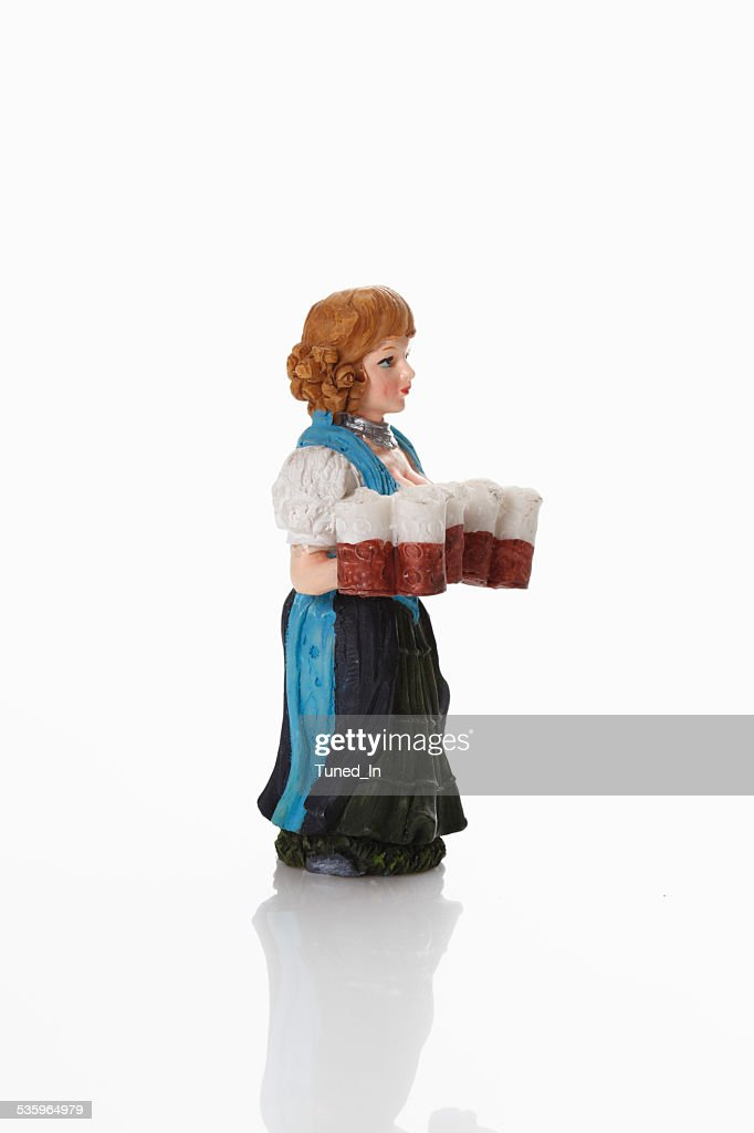 Bavarian waitress figurine carrying beer glass : Stock Photo