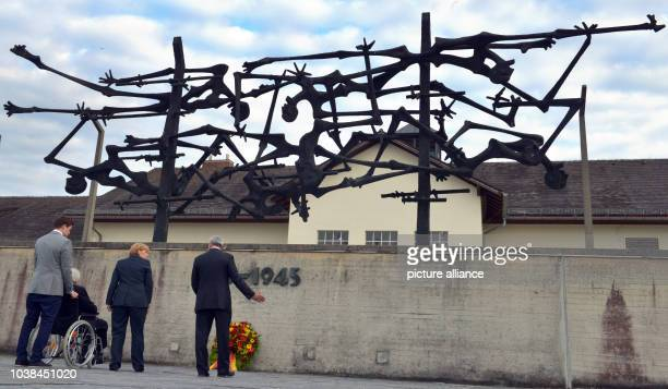 Bavaria's Minister of Culture Ludwig Spaenle German Chancellor Angela Merkel and Max Mannheimer survivor of the Holocaust stand in front of a...