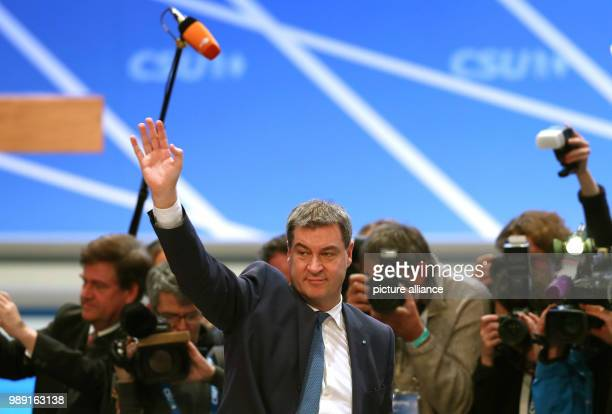 Bavaria's Minister of Finance Markus Soeder of the Christian Social Union waves after his election as Premier and successor of Seehofer during the...