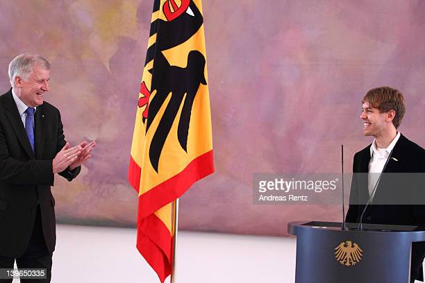 Bavaria's state governor and German Interim President Horst Seehofer awards German Formula 1 Driver Sebastian Vettel the Silbernes Lorbeerblatt Award...
