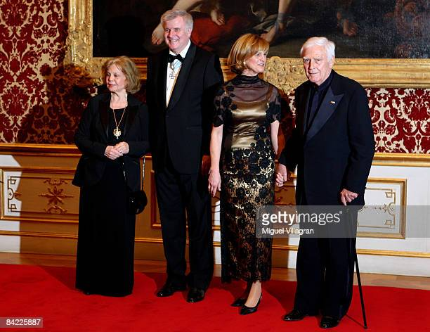 Bavaria's state governor and leader of the Christian Social Union Horst Seehofer and his wife Karin Seehofer greet actor Joachim Fuchsberger and his...