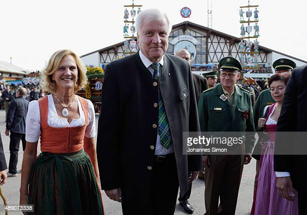 Bavaria's state governor Horst Seehofer and his wife Karin Seehofer arrive for the opening day of the 2015 Oktoberfest on September 19 2015 in Munich...