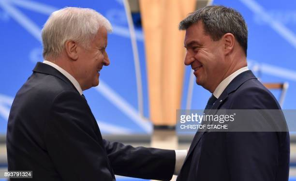 Bavaria's state Premier and chairman of the Bavarian Christian Social Union party Horst Seehofer laughs with Bavarian Finance Minister Markus Soeder...