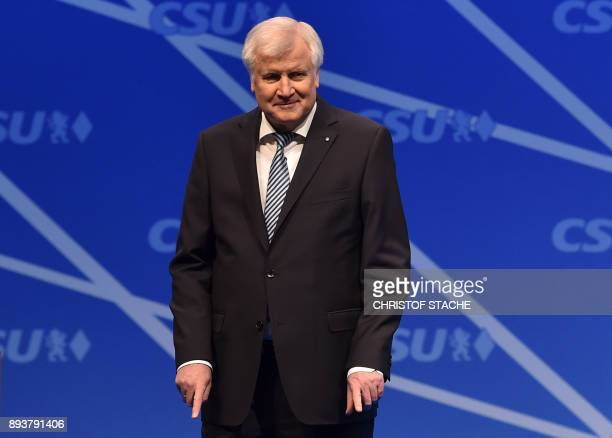 Bavaria's state Premier and chairman of the Bavarian Christian Social Union party Horst Seehofer gestures after his speech on December 16 2017 in...