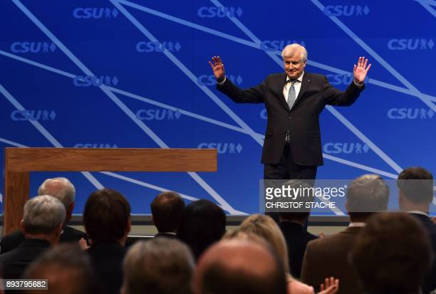 Bavaria's state Premier and chairman of the Bavarian Christian Social Union party Horst Seehofer waves after his speech on December 16 2017 in...