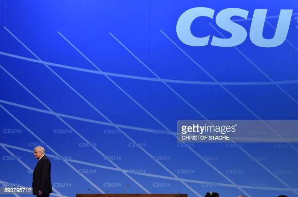 Bavaria's state Premier and chairman of the Bavarian Christian Social Union party Horst Seehofer walks at the stage after his speech on December 16...