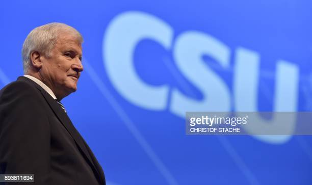 Bavaria's state Premier and chairman of the Bavarian Christian Social Union party Horst Seehofer stands at the stage after his speech on December 16...