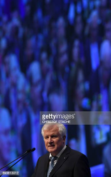 Bavaria's state Premier and chairman of the Bavarian Christian Social Union party Horst Seehofer speaks on December 16 2017 in Nuremberg southern...