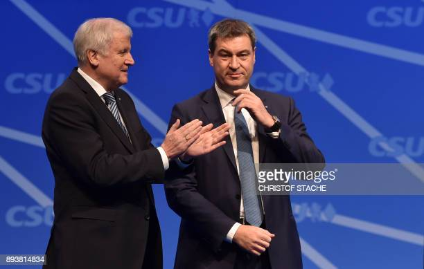 Bavaria's state Premier and chairman of the Bavarian Christian Social Union party Horst Seehofer applauses Bavarian Finance Minister Markus Soeder at...