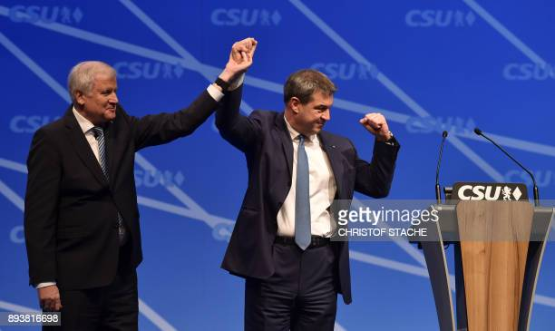 Bavaria's state Premier and chairman of the Bavarian Christian Social Union party Horst Seehofer and Bavarian Finance Minister Markus Soeder wave at...