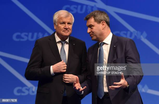 Bavaria's state Premier and chairman of the Bavarian Christian Social Union party Horst Seehofer gestures with Bavarian Finance Minister Markus...
