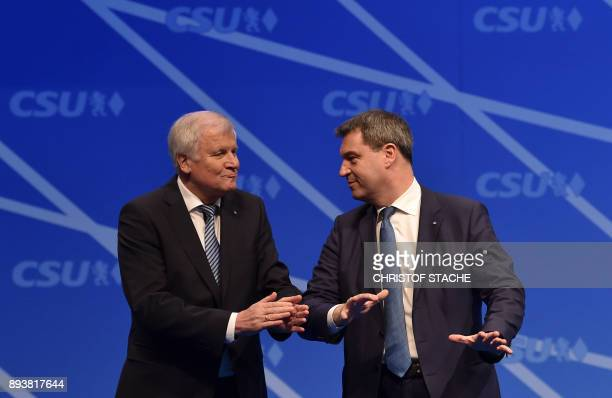 Bavaria's state Premier and chairman of the Bavarian Christian Social Union party Horst Seehofer applauses for Bavarian Finance Minister Markus...