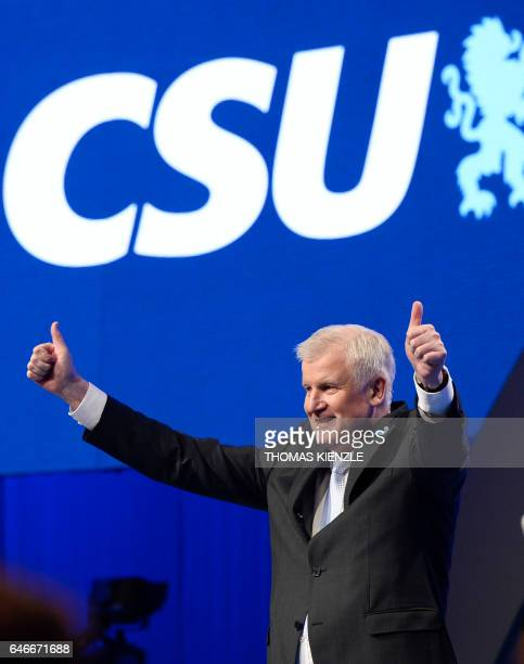 Bavaria's State Premier and leader of the conservative Christian Social Union Horst Seehofer reacts on the stage after his speech during his party's...