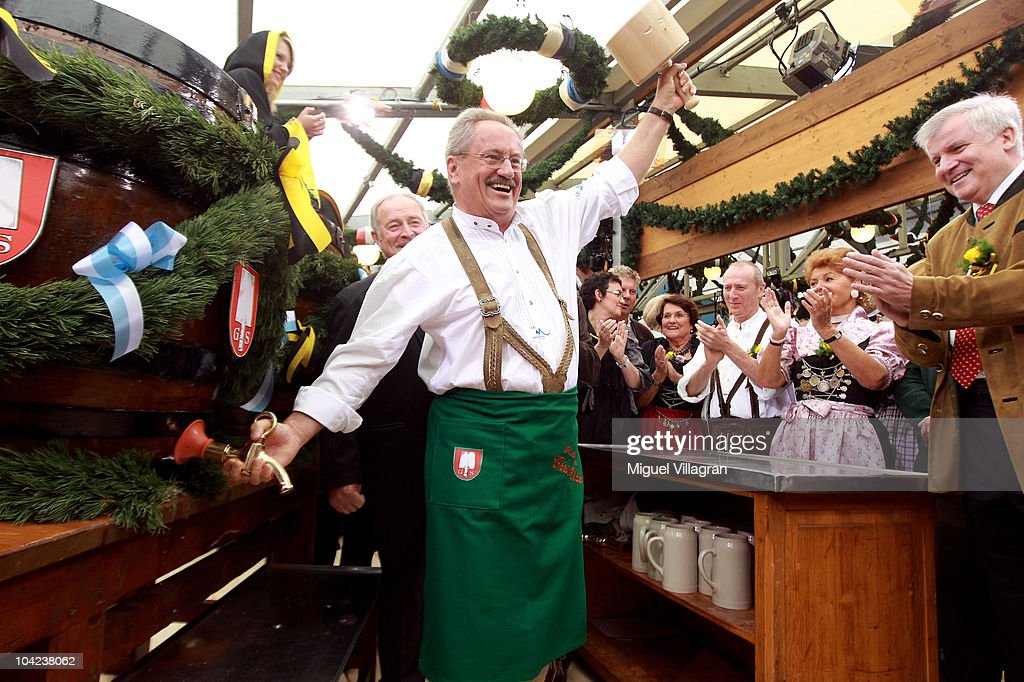 Bavaria's State Premier Horst Seehofer applauds as Munich's mayor Christian Ude opens the first beer barrel to start the Oktoberfest beer festival at the Schottenhamel beer tent during the opening day of the Oktoberfest at Theresienwiese on September 18, 2010 in Munich, Germany. 2010 marks the 200th anniversary of Oktoberfest.The Oktoberfest tradition started in 1810 to celebrate the October 12th marriage of Bavarian Crown Prince Ludwig to the Saxon-Hildburghausen Princess Therese. The citizens of Munich were invited to join in the festivities which were held over five days on the fields in front of the city gates. The main event of the original Oktoberfest was a horse race. The world's biggest beer festival will last this year from September 18 to October 4.