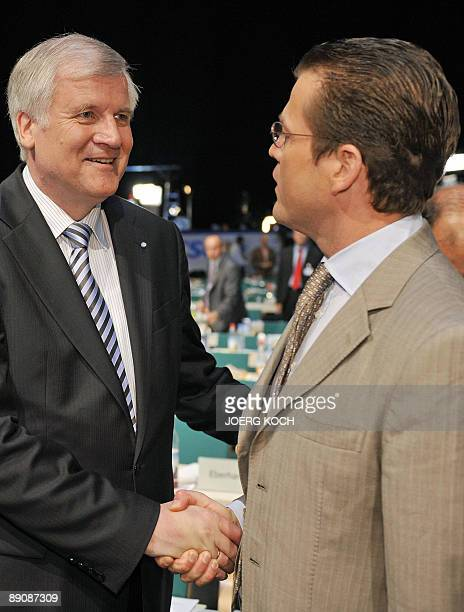 Bavaria's State Premier Horst Seehofer shakes hands with German Economy Minister KarlTheodor zu Guttenberg at the end of the CSU party congress on...