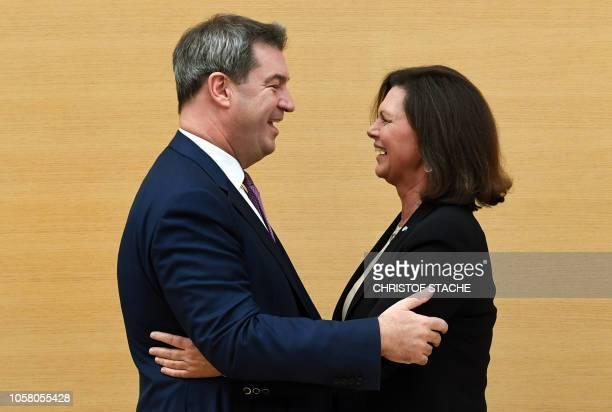 Bavaria's State Premier Markus Soeder hugs Ilse Aigner President of the Bavarian Parliament after he was reelected as Bavarian State Premier during...